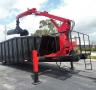 USED 2011 X ROLL OFF PETERSON GRAPPLE LOADER ROLL OFF CONTAINER1
